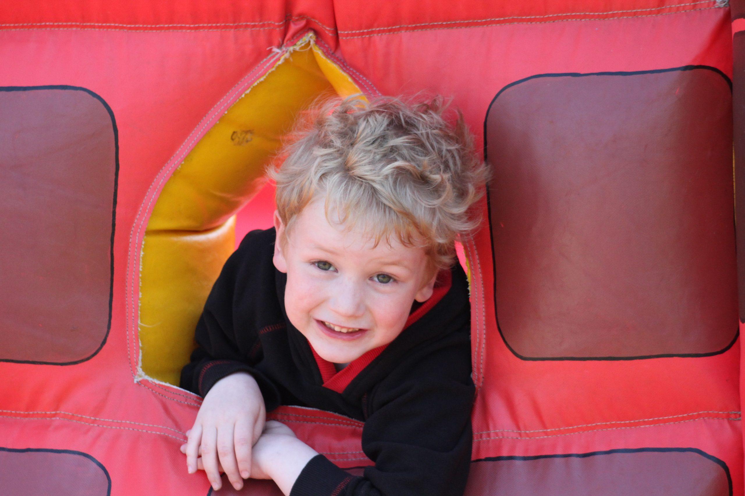 Portrait of little boy on a bouncy castle
